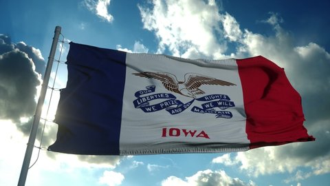 Flag of Iowa waving in the wind against deep beautiful clouds sky