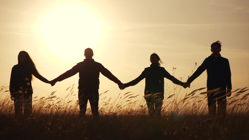 teamwork. team community hold hands together silhouette at sunset unity. group of people hands. teamwork a workers carry out one mission go the goal business. team in the company working partnership Royalty-Free Stock Footage #1062634447