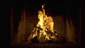 A Looping Clip of a Fireplace with Medium Size Flames Burning Fire Slow Motion. Warm Cozy Fireplace with Real Wood Burning in it Winter and Christmas Holidays Concept