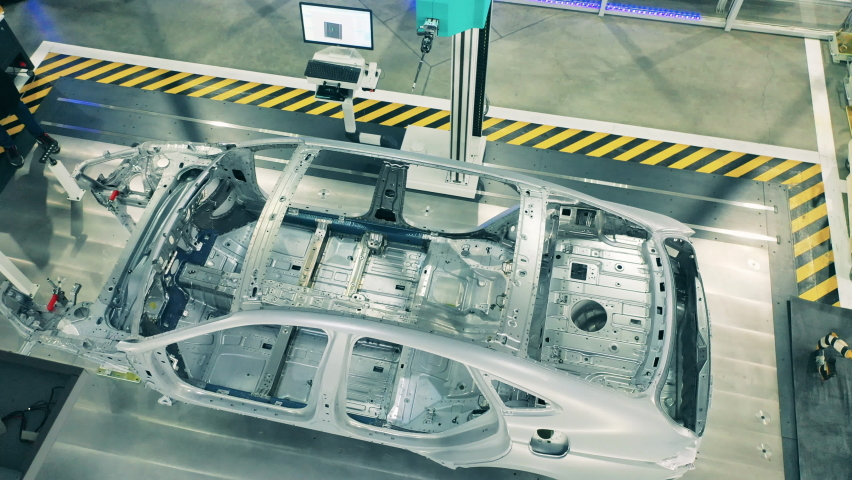 Top view of car body framework at car factory. Automotive factory equipment. Royalty-Free Stock Footage #1062710482