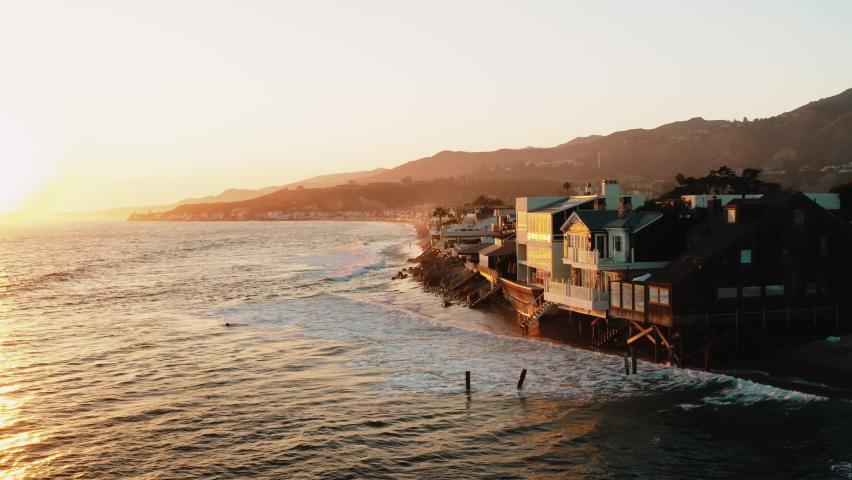 Malibu Colony Beach. Real Estate. Cinematic aerial shots of Malibu Communities. Beautiful sunset and ocean view /  Malibu, California, US