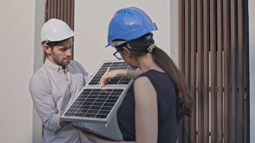 Electrical Engineer Technician Talk to business people to invest in install solar cells outside building or industrial factory. Collaboration on energy reduce for environment. Concept key worker Royalty-Free Stock Footage #1062750415