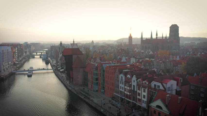Amazing cityscape of Gdansk over Motlawa river at sunset, Poland Royalty-Free Stock Footage #1062755593