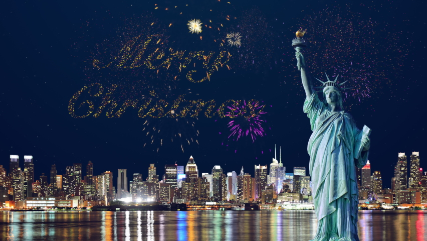 United States of America, New Year's fireworks exploding above New York City and merry christmas tex written with particle effect