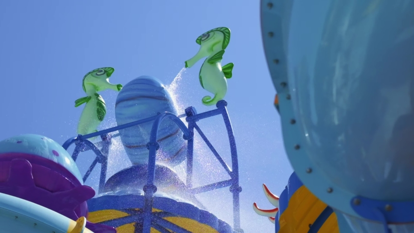 Animated characters in the aqua park. seahorses are filling the bucket with water. the filled bucket spills down and the slow motion shooting of the spilling water from the top. Royalty-Free Stock Footage #1062788599