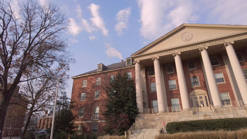 Bethesda, MD, USA 11/21/2020: Exterior view of the main historic building (Building 1) of National Institutes of Health (NIH) inside Bethesda campus. NIH funds majority of biomedical research in USA
