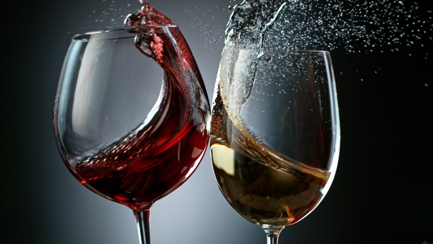 Super Slow Motion Shot of Clinking Red and White Wine at 1000fps.   Shutterstock HD Video #1062796030