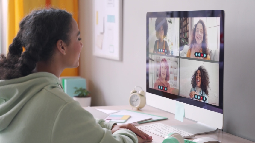 African american teenage girl chatting with happy multiethnic diverse teen friends during online virtual chat video call in group conference distance chat virtual meeting using computer at home. Royalty-Free Stock Footage #1062840187