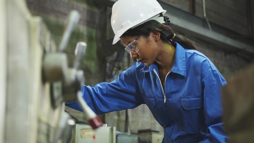 Candid asian female Professional engineering wearing uniform and safety goggles Quality control, maintenance, check in factory, warehouse Workshop for factory operators | Shutterstock HD Video #1062846796