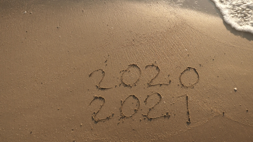 Message Year 2020 replaced by 2021 written on beach sand background. Good bye 2020 hello to 2021 Lapping waves happy New Year coming concept Royalty-Free Stock Footage #1062867259