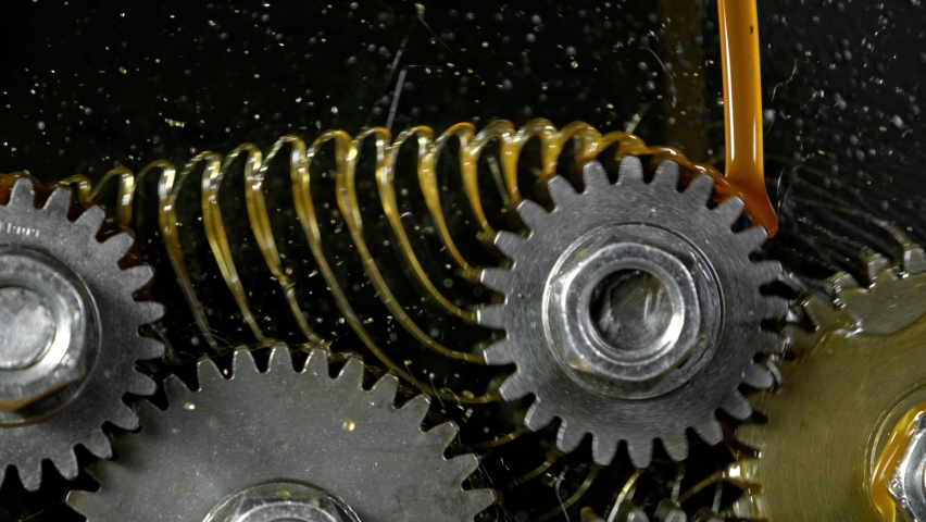 Super Slow Motion Shot of Gear Mechanism and Oil on Dark Background at 1000 fps. Royalty-Free Stock Footage #1062867940