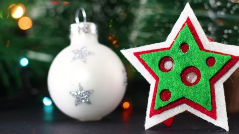 White Christmas ornament and Christmas star with blinking lights