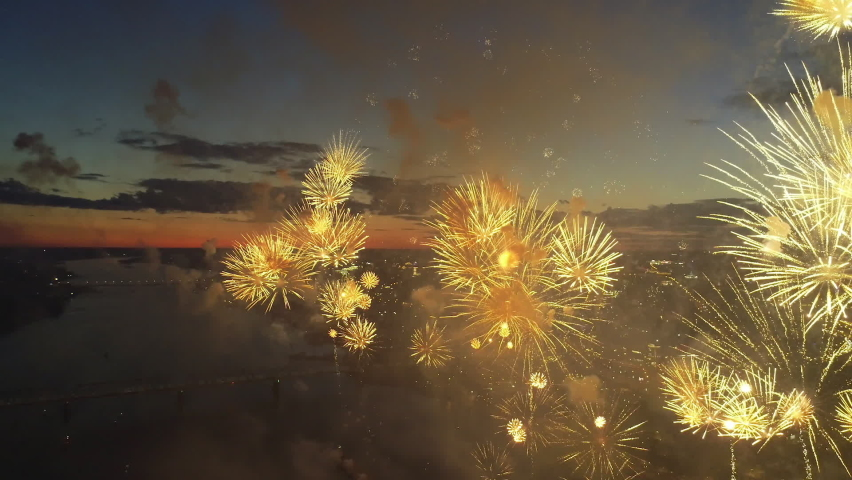 Aerial View Fireworks City Sky. New Year Eve Fly Drone Scene. City Celebrate Night Lights. Flight Above Sparks Firework Explode Festive. Bright Explosion Fireworks on Evening Urban Skyline Background Royalty-Free Stock Footage #1062883162