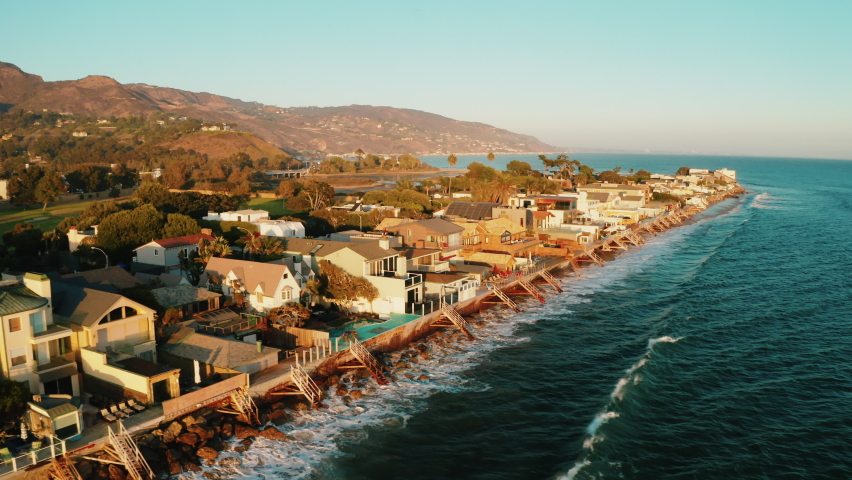 Malibu Colony Beach. Real Estate. Most expensive and Luxuries Beach Front properties in Los Angeles County. Cinematic aerial shots of Malibu Communities. Beautiful sunset and ocean view.