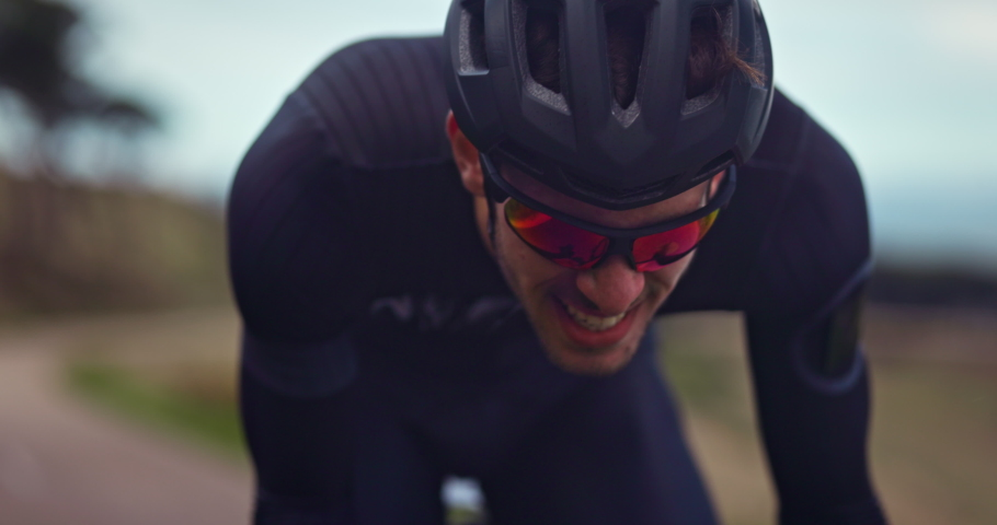 Professional cyclist struggling to ride bicycle during training Royalty-Free Stock Footage #1062888670