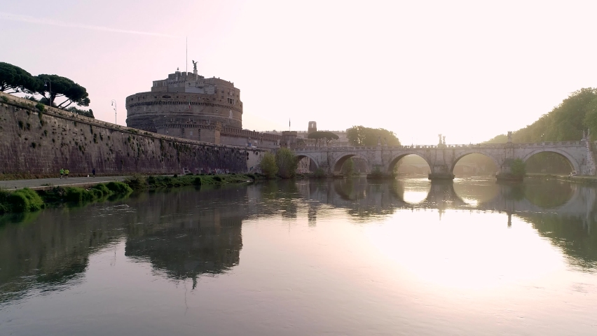 Aerial drone view, castle sant 'Angelo, shot with drone crossing  under the bridge with the sunrise : - rome, italy   Shutterstock HD Video #1062896827