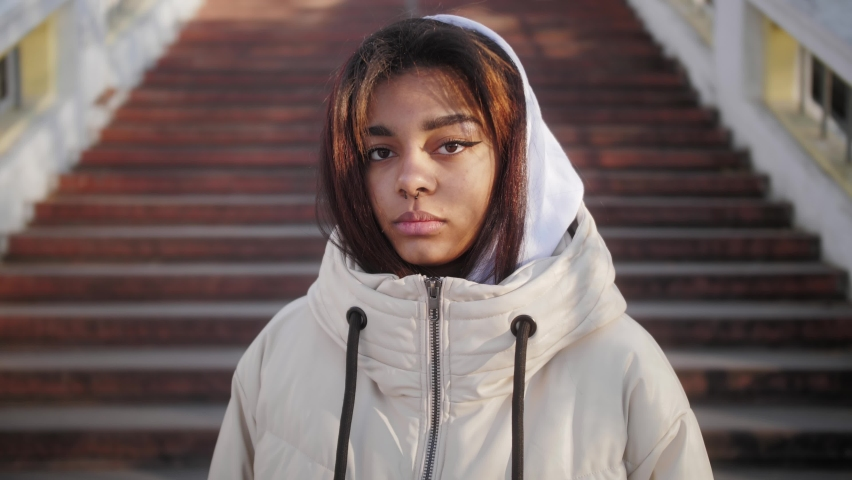 Portrait of confident young black woman looking serious at camera. Independent african american female on the city background. Royalty-Free Stock Footage #1062922939
