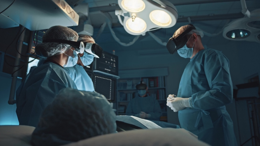 Multi-race professional group of surgeon, nurses and interns using augmented reality practicing surgical operation with newest VR technologies. | Shutterstock HD Video #1062955642