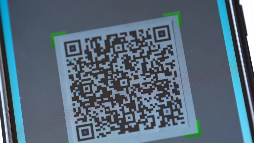 QR code scanning app. QR code reader and QR code scanner on smartphone screen. Touchless digital option for businesses, marketing, payment, shopping and E-commerce   Shutterstock HD Video #1062963646