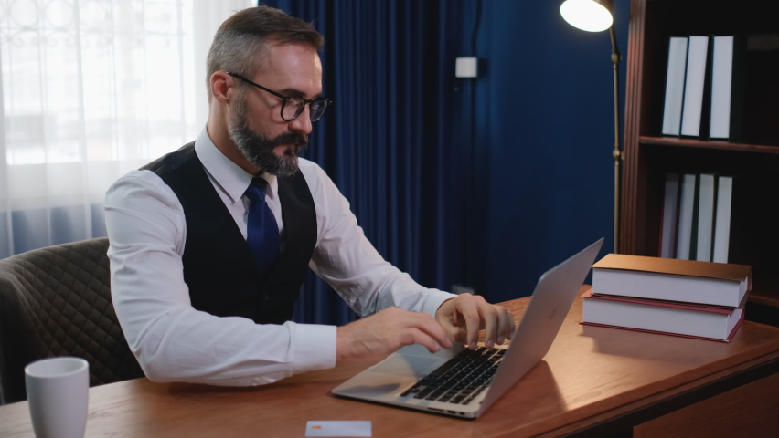 Business man sit in office or home office and enjoy of online shopping by using his credit card to order some products. Concept of online technology support new normal business system.   Shutterstock HD Video #1062964186