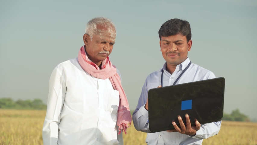 Farmer and banker or corporate government officer discussing on laptop about crop yield, credit and loan subsidy at agriculture farmland during hot sunny day.   Shutterstock HD Video #1062965062
