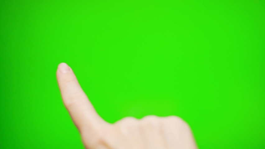 Close up the Finger Touches Flips Slides Moves Scrolls on the Green Screen, Green Background, Alpha Channel, ChromaKey.of a Touch-Sensitive Touch Screen Laptop Tablet Digital Device.    Shutterstock HD Video #1062965191
