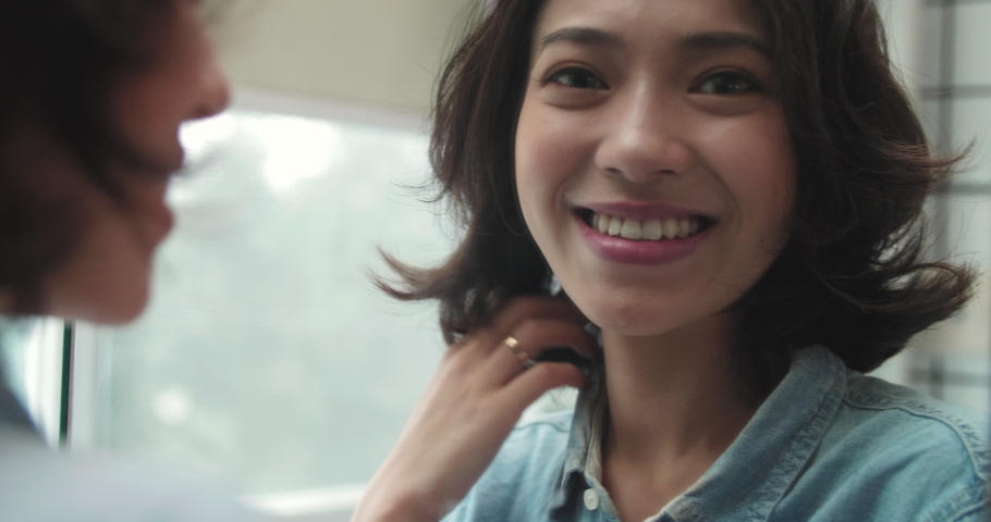 beautiful young smiling girl with short curly hair looking into the mirror confidently with self appreciation and self trust pretty young Asian woman looking at camera smile through  Royalty-Free Stock Footage #1062972970