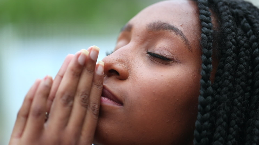 Spiritual young black woman face looking at sky with HOPE and FAITH. Royalty-Free Stock Footage #1062983968