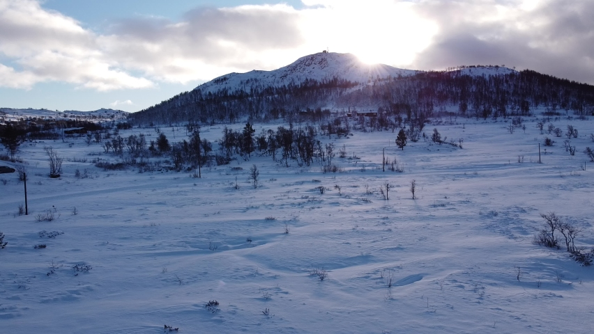 Cross Country Ski Track With Mountain and Sun Rise in Background
