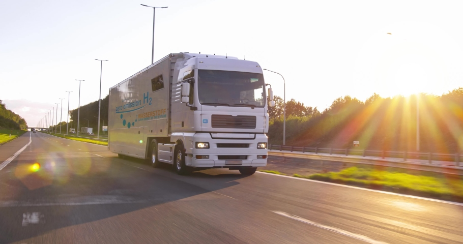hydrogen fueled truck on the road driving. h2 combustion Truck engine for emission free ecofriendly transport Royalty-Free Stock Footage #1063003249