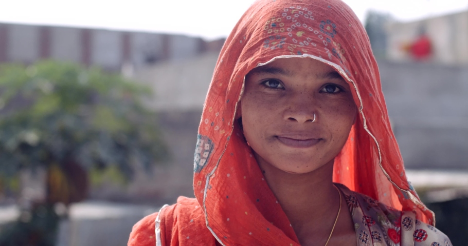 Young Indian adult woman in traditional clothes wears a face mask for protection from pollution and viruses outdoors  Royalty-Free Stock Footage #1063034677