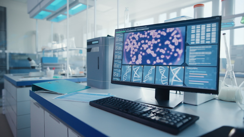 Modern Medical Research Laboratory with Computer, Microscope, Glassware with Biochemicals on the Desk. Scientific Lab Biotechnology Development Center Full of High-Tech Equipment. Moving Shot   Shutterstock HD Video #1063037578