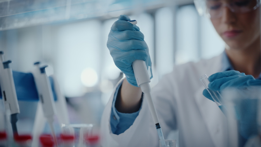 Medical Research Laboratory: Portrait of a Beautiful Female Scientist Using Micro Pipette for Analysis. Advanced Scientific Lab for Medicine, Biotechnology, Microbiology Development. Hands Close-up | Shutterstock HD Video #1063037659