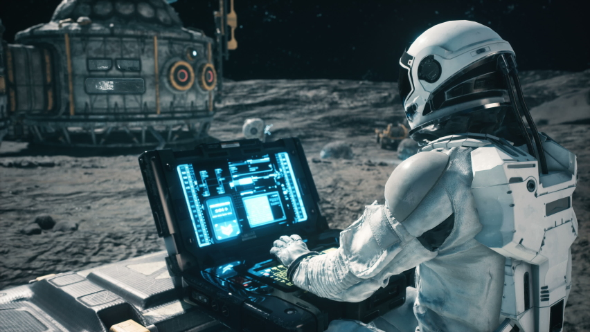 An astronaut works on his science laptop in a space colony on one of the planets. Looping Animation for fantasy, futuristic or space travel. | Shutterstock HD Video #1063052539
