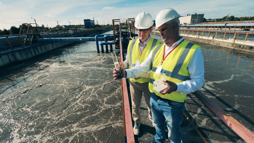 Wastewater treatment concept. Inspectors are analyzing wastewater probes