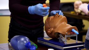 Close-up detail of a training dummy. Medical doll ready for a training. Healthcare and education concept video.