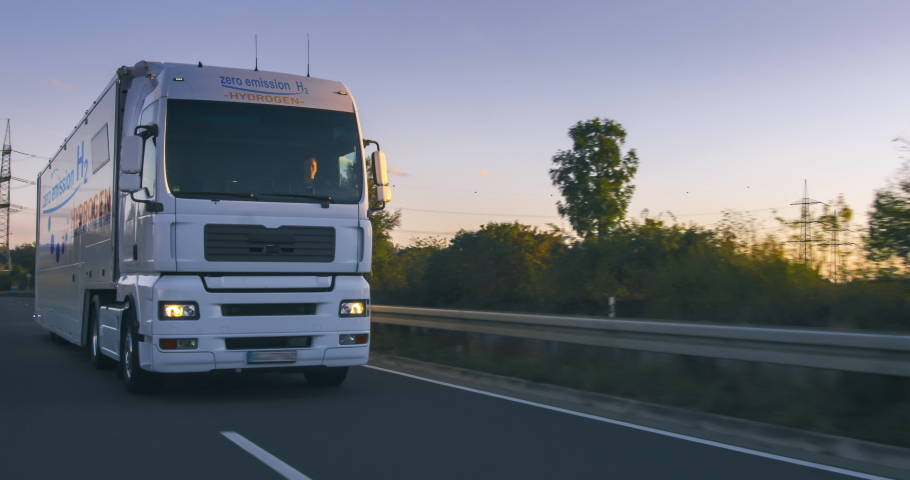 hydrogen fueled truck on the road driving. h2 combustion Truck engine for emission free ecofriendly transport Royalty-Free Stock Footage #1063087462