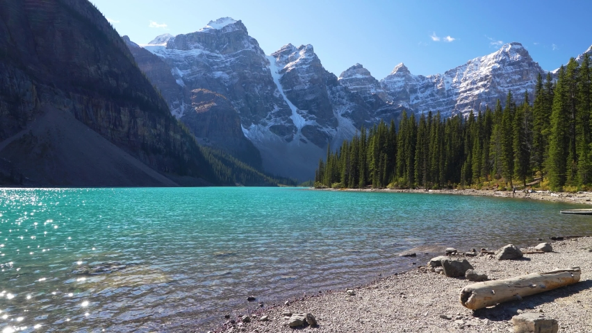 Moraine lake beautiful landscape in summer to early autumn sunny day morning. Sparkle turquoise blue water, snow-covered Valley of the Ten Peaks. Banff National Park, Canadian Rockies, Alberta, Canada | Shutterstock HD Video #1063088362