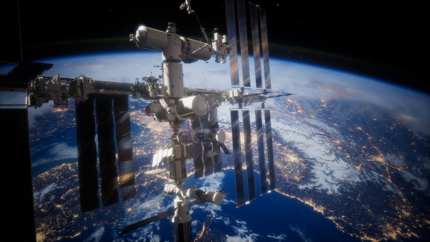 A view of the Earth and a spaceship. International space station is orbiting the Earth, Elements furnished by NASA. | Shutterstock HD Video #1063103860