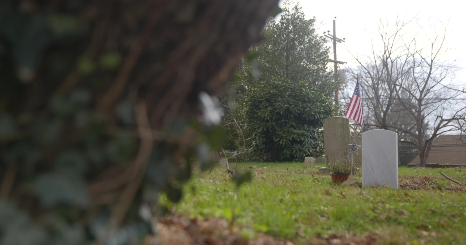 Two graves with American flag background