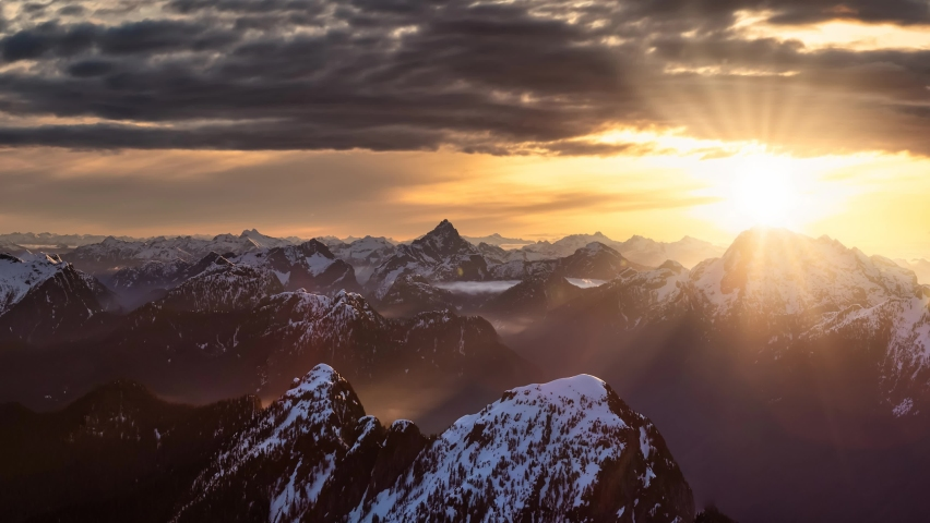 Cinemagraph Continuous Loop Animation. Aerial Panoramic View of Remote Canadian Mountain Landscape. Dramatic Colorful Sunrise Art Render. Located near Vancouver, British Columbia, Canada.
