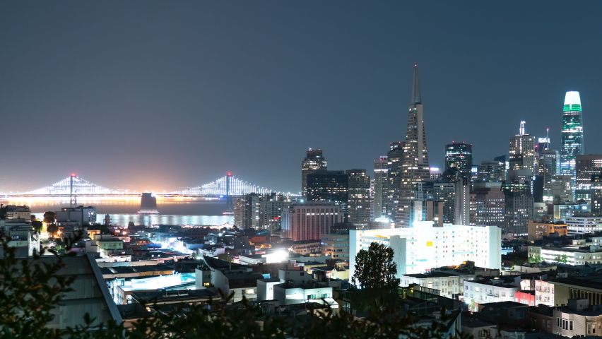 San Francisco Financial District Skyline and Bay Bridge from Russian Hill Night Time Lapse California USA