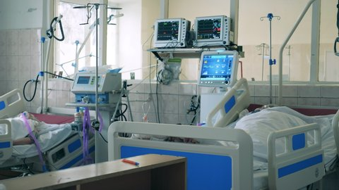 Covid-19 hospital, coronavirus, medical, healthcare concept. Medical worker is helping a patient with a lung ventilator
