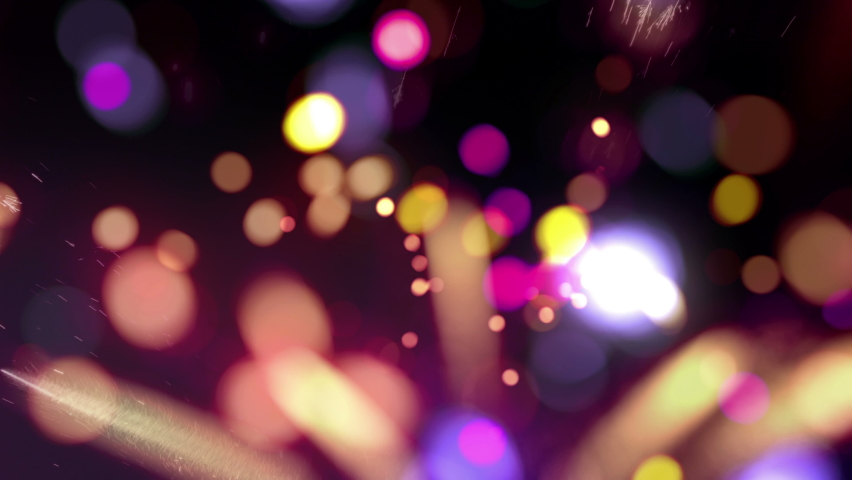 Fireworks with Bokeh Effect Shining in night sky. Real fireworks background. Abstract Blur Golden fireworks in the Night Sky. Perfect New year's Eve celebration. Multicolored Fireworks Show  Royalty-Free Stock Footage #1063166896