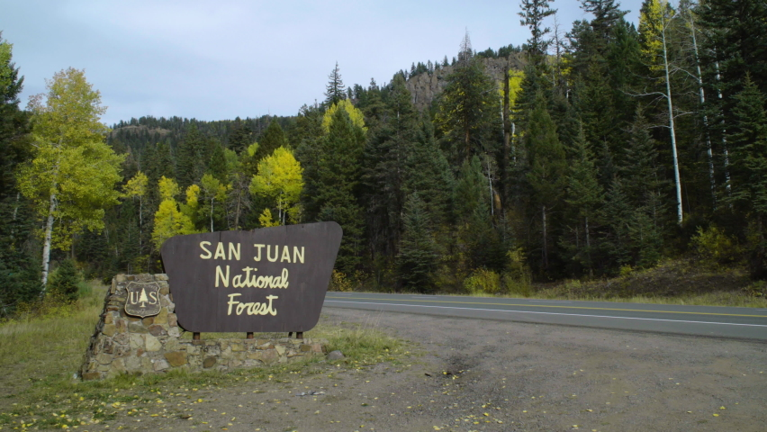 San Juan National Forest area sign by the road. Clips of US 160 heading to Treasure Falls Colorado and two of Treasure Falls signs and area. In Pagosa Springs, Colorado, U.S.