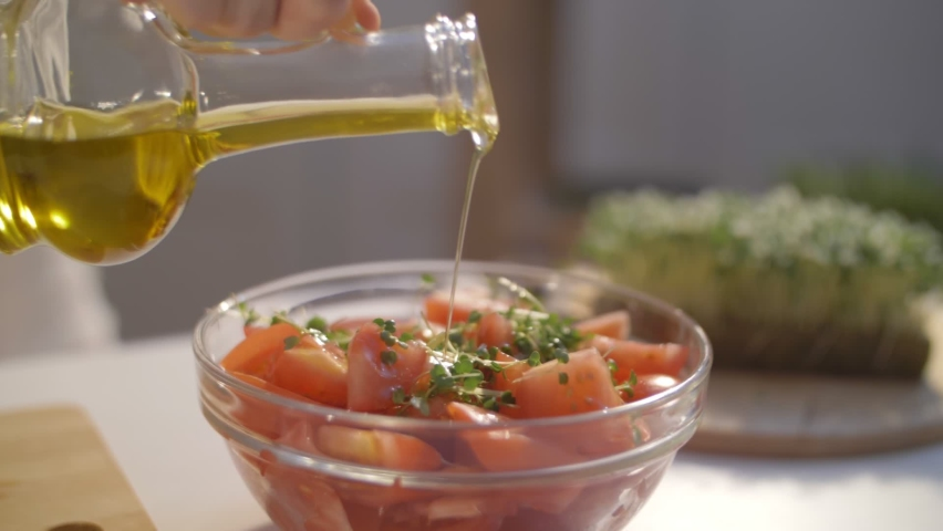fresh tomato salad with microgreens and olive oil. olive oil pouring, organic vegetables, vegan diet. arugula micro greens. tomato harvest Royalty-Free Stock Footage #1063178572