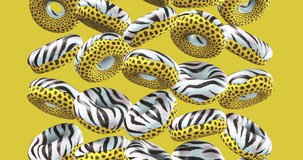 Minimal motion design. 3d creative animal prints donuts on yellow background. Fast food concept art. 4k video