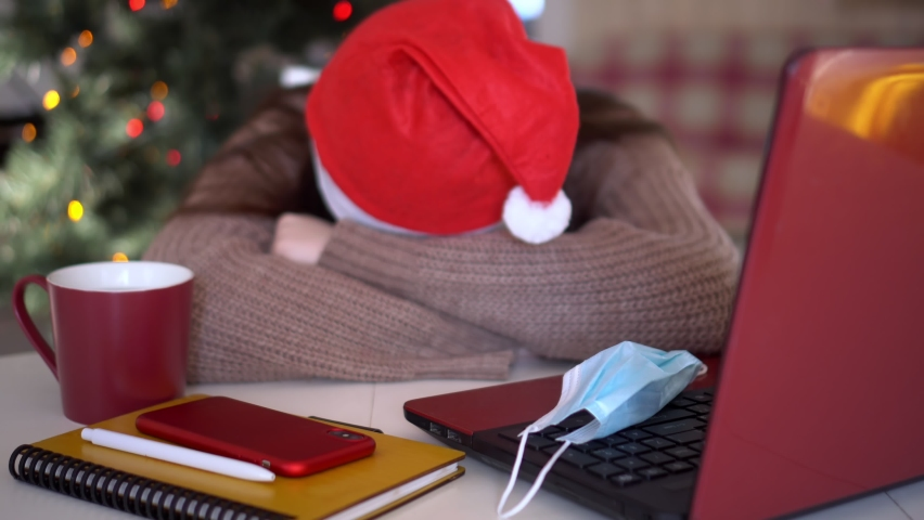 female studentin santa hat makes conference video call on laptop computer talks with web tutor, online teacher in remote webcam chat on screen. Distance education class concept. Royalty-Free Stock Footage #1063188181