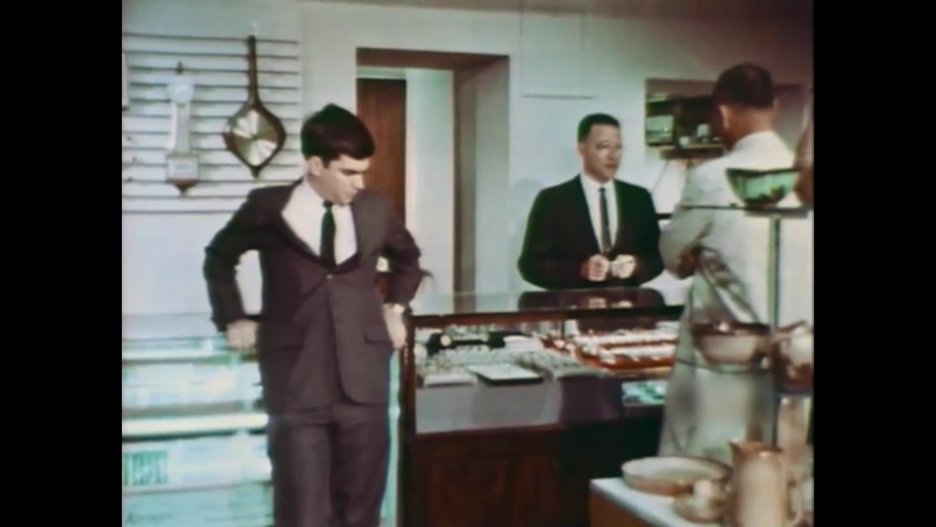 CIRCA 1964 - An engaged couple argue over an expensive wedding ring.