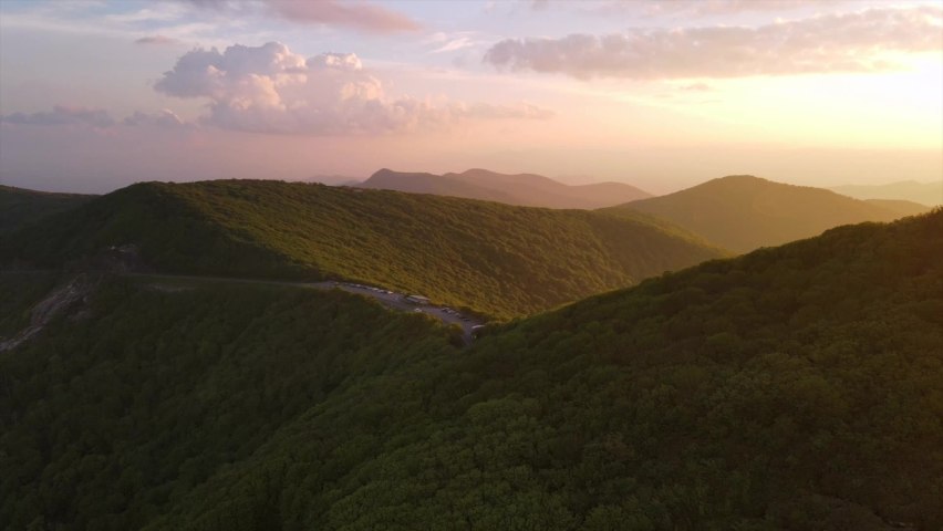 ASHEVILLE, NORTH CAROLINA - CIRCA 2020 - Aerial over the Blue Ridge Mountains at sunset near Asheville, North Carolina.